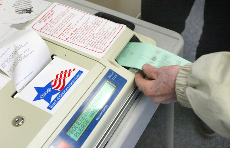 A voter submits his ballot to a punch-card reader in Chicago during a primary election in March.