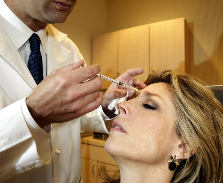 A Philadelphia doctor injects  into the brow of a patient in this April 2002 file photo. Botox is onlyone manifestationof a penchant for personal reinvention that extends to our sex lives, our relationships and our homes.