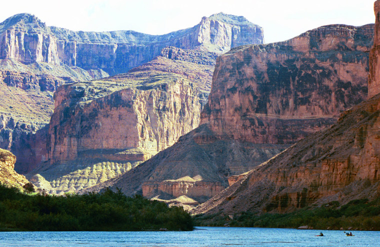 The Grand Canyon still imposes its majesty on visitors like the kayakers seen at right on the Colorado River, but a closer look finds a crumbling ecosystem.
