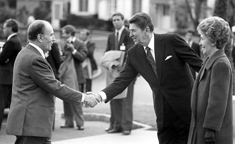 French President Francois Mitterrand is welcomed in 1984 to the American cemeterynear Omaha Beach by President Ronald Reagan and his wife Nancy.