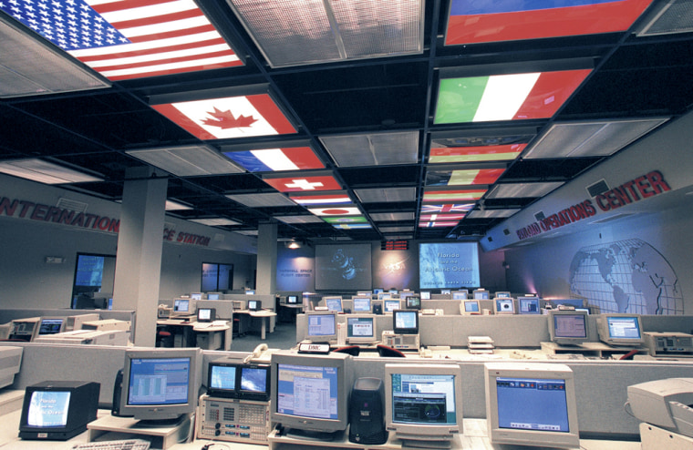 The flags of the nations involved in the international space station light up workstations in NASA's high-tech Payload Operations Center, at Marshall Space Flight Center in Huntsville, Ala.