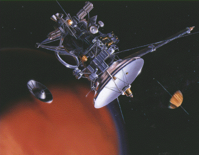 An artist's conception shows the Cassini spacecraft flying by the moon Titan and releasing its Huygens lander, with Saturn in the background. Cassini is due to arrive at Saturn on Wednesday.