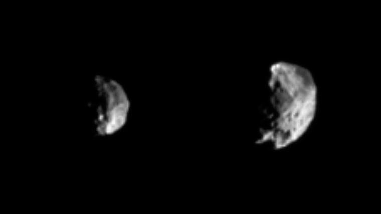 Phoebe grows larger and larger in these two views, captured by the Cassini spacecraft on Thursday. A large crater is visible in the image at left, taken from 594,000 miles away.The image at right, taken from a distance of 409,000 miles, shows a body heavily pitted with craters of varying sizes. Cassini flew within 1,240 miles of the moon on Friday.