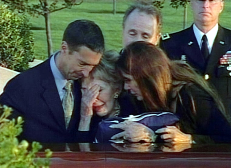 Former first lady Nancy Reagan, center, weeps as she touches the casket of her late husband, former President Ronald Reagan.