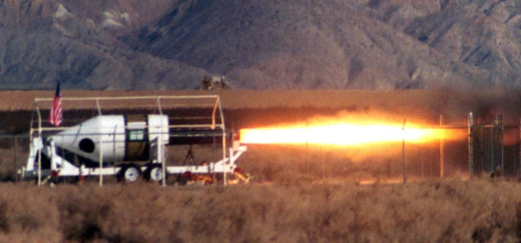 SpaceShipOne officials have chosen SpaceDev's hybrid rocket propulsion system, shown here during an engine test. The system uses nitrous oxide and a rubber component known as HTPB.