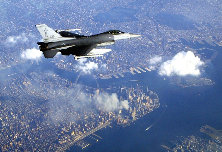A Vermont Air National Guard F-16 Falcon flies over New York City during an air defense mission on Sept. 12, 2001.