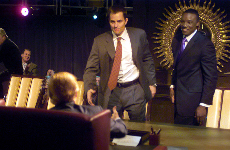 """Bill Rancic, center, winner of """"The Apprentice"""" walks up to shake hands with Donald Trump in the finale for the NBC show."""