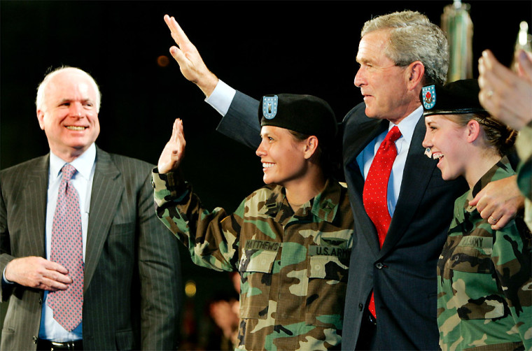 US PRESIDENT BUSH WAVES WITH US MILITARY PERSONNEL AT FT LEWIS