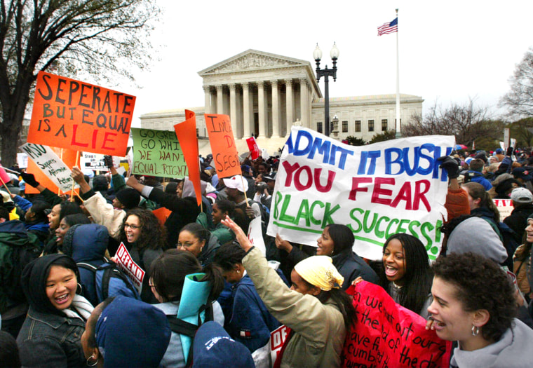 Students demonstrate outside the Supreme Court as it debated on April 1, 2003 in Washington whether colleges and universities could legally consider race when admitting students.