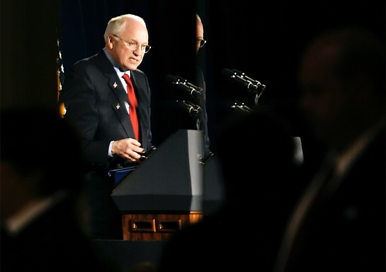 Vice President Dick Cheney is reflected in a mirror as he speaks earlier this year in Milwaukee.