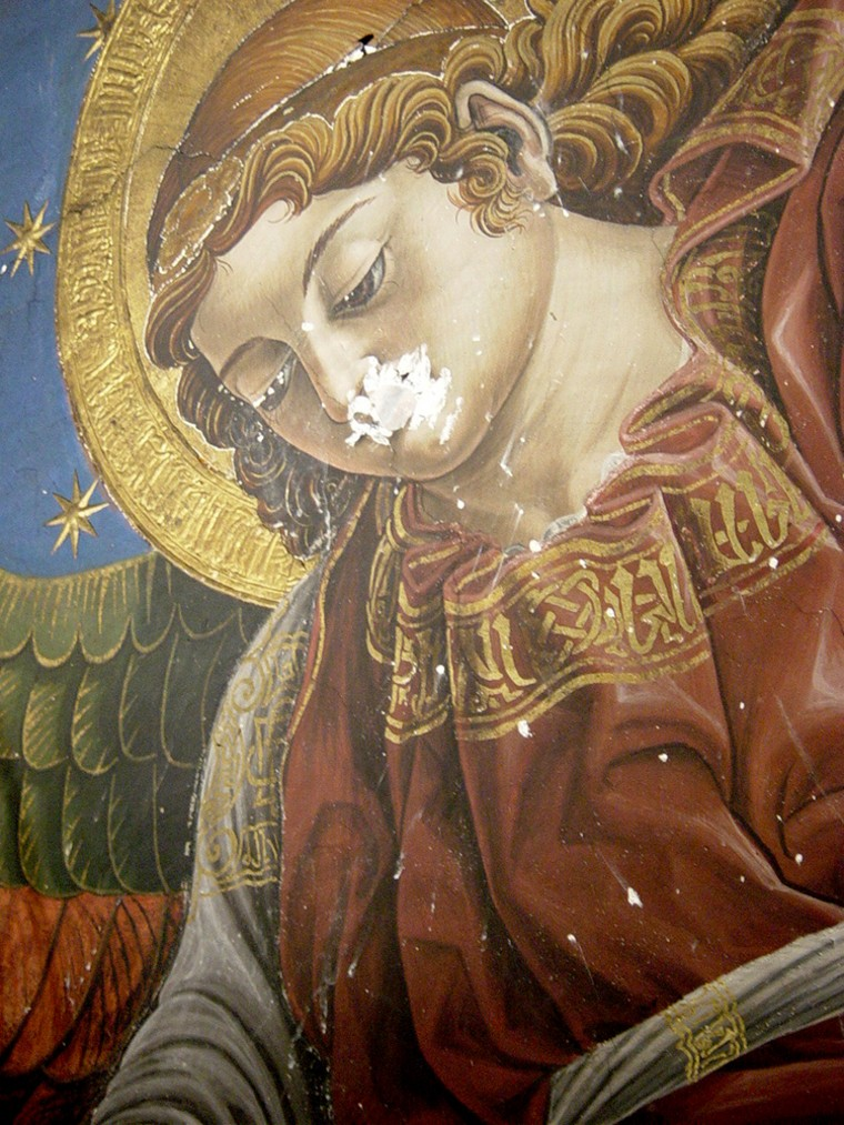 A partial view of a Renaissance fresco, found by an art restoration team, shows an angel's head, surrounded by a halo and stars. The work of art, thought to have been painted by Francisco Pagano and Pablo de San Leocadio in 1481, was found during repairs of Valencia's cathedral.