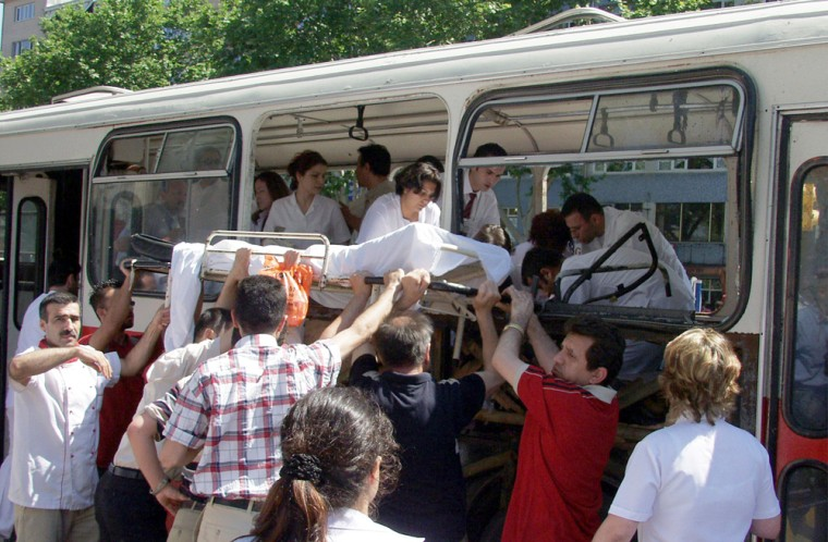 Medics carry awayinjured victims Thursday after a bomb exploded aboard a city bus inIstanbul.