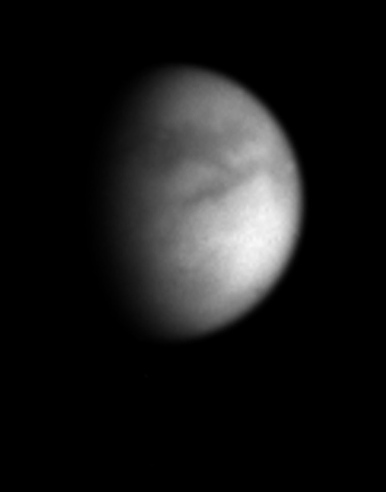 Cassini's latest picture of Titan reveals what appear to be bright and dark regions on the surface in unprecedented detail. The picture was taken using a filter designed to cut through the thick haze surrounding the Saturnian moon.