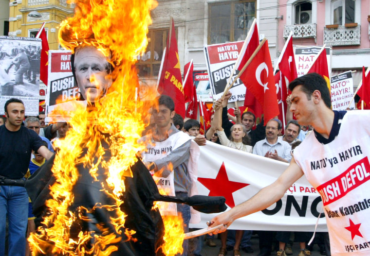Members of Turkey'sleft-wing Labor Party set fire toan effigy ofPresident Bush in downtown Istanbul on Sunday,just hours before Bush's arrival for a NATO summit.