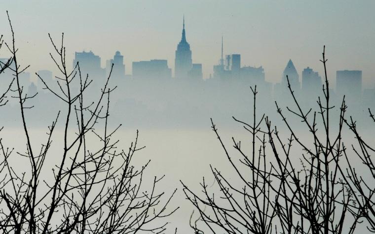 New York skyline looms above early morning fog over Hudson River