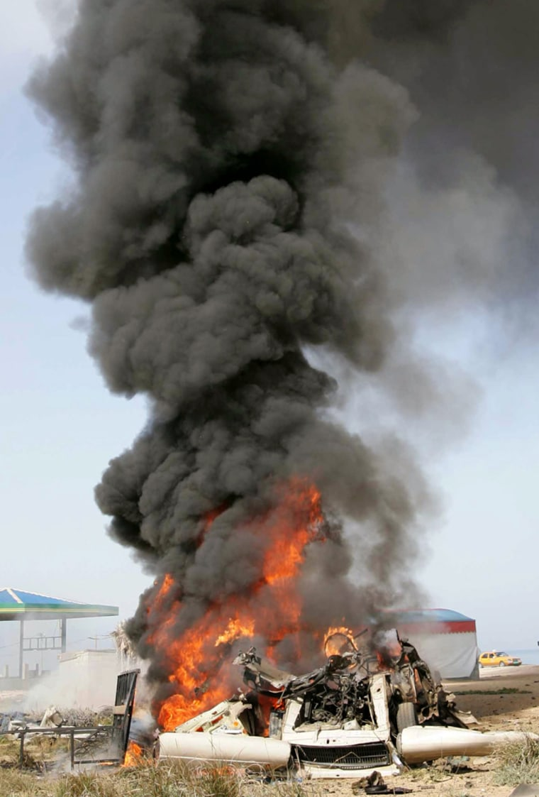 A vehicle allegedly used by Palestinian militants burns in Gaza after being hit by an Israeli airstrike on Thursday.
