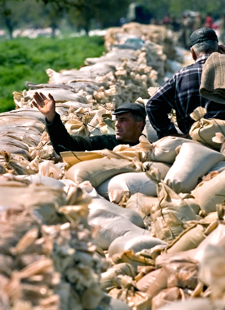 Sandbags are piled up Thursday in Manastire, Romania, where some areashave already seen Danube flooding.