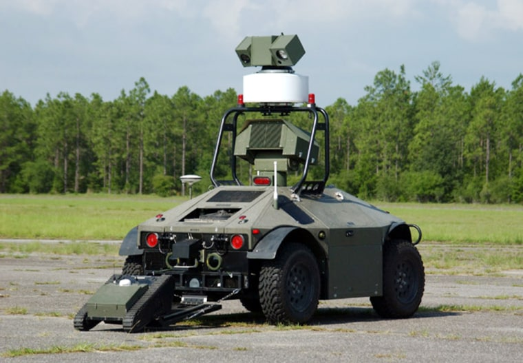 The Mobile Detection and Response System, or MDARS, launches a mini-robot called Matilda during a demonstration Tuesday at Eglin Air Force Base, Fla., earlier this month.