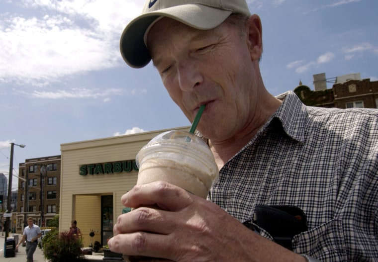 Gary Lass takes a sip from his grande mocha Frappuccino with whipped cream that he bought from a Starbucks in Seattle June 25.