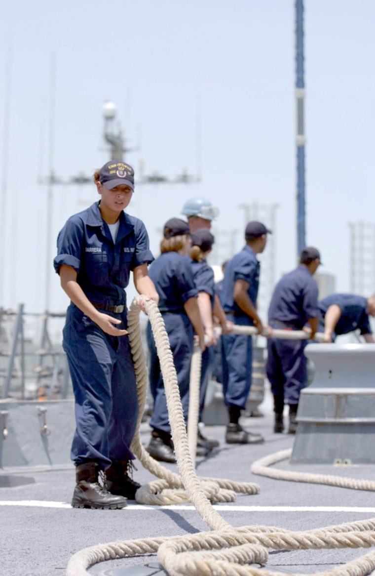 Sailors prepare for the arrival of a ship at the U.S. Navy port in Manama, Bahrain,home to the5th Fleet.