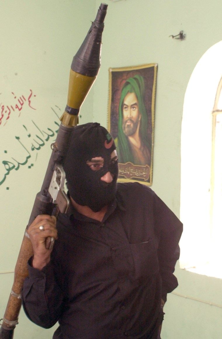 A militant loyal to rebel clericMuqtada al-Sadr stands in a home in Baghdad's Sadr City neighborhood on June 28.
