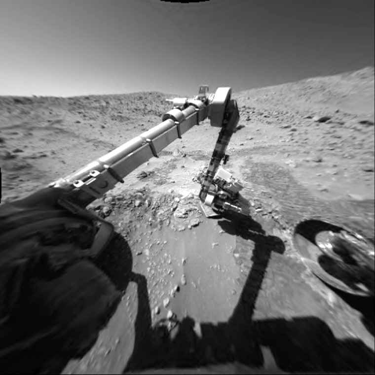"""Spirit uses its microscopic imager to get an up-close look at the rock target """"Bread Basket,"""" at the base of the Columbia Hills. The rover will soon climb up the hills."""