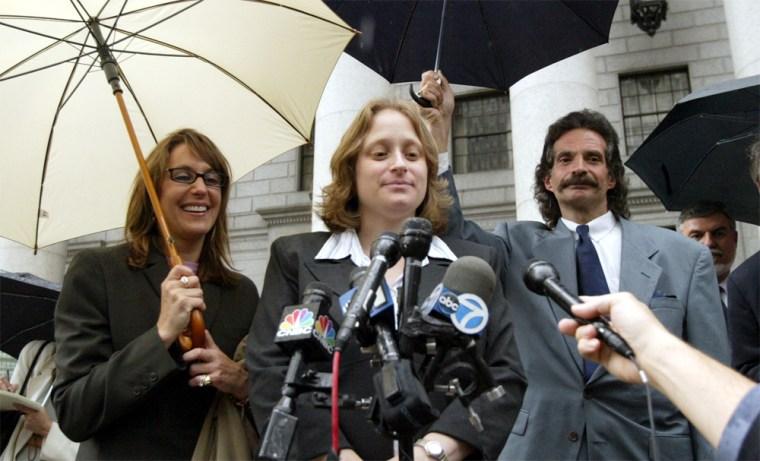 Allison Schieffelin, left, stands with EEOC attorney Elizabeth Grossman, center and EEOC assistant director of public affairs Larry Pincus after settling a sex discrimination suit againstMorgan Stanley.