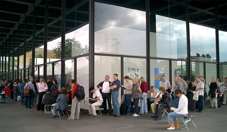 """Line outside of the Neue Nationalgalerie in Berlin waiting to see the """"Museum of Modern Art in Berlin"""" exhibit."""