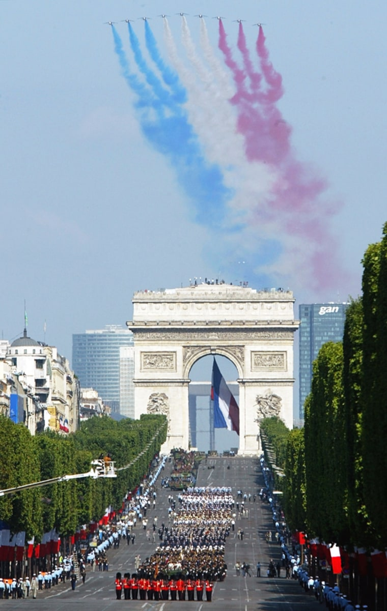 French fighter planes fly over the Arc de Triomphe as British soldiers lead the Bastille Day military parade down the Champs Elysees in Paris, on Wednesday.