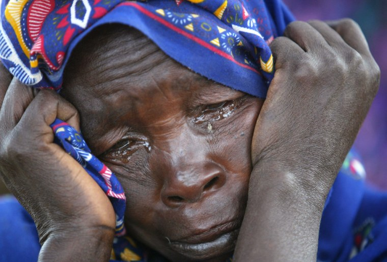 A Sudanese refugee cries moments after she and her family reach the safety of Bahai on the Chad border, onJuly 9 afterhiding from Arab gunmen in the hillsof Sudan's Darfur province for nearly a year.