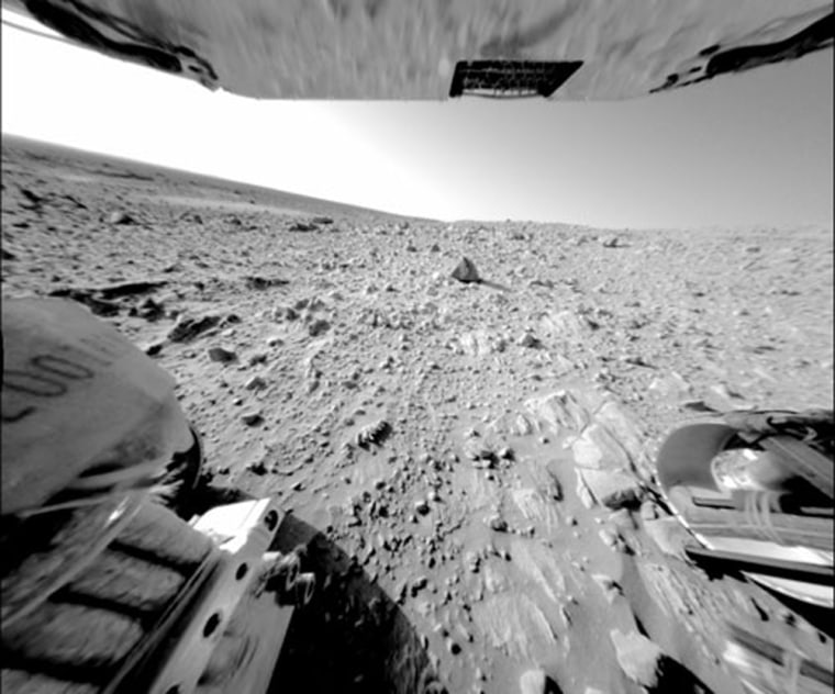 """A large, continuous rock outcrop at the base of the """"Columbia Hills"""" is seen in this image taken by Spirit's rear hazard-avoidance camera."""
