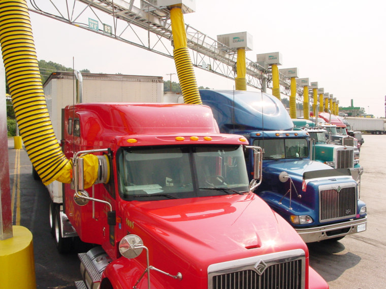 Trucks at the Petro Travel Center in Knoxville, Tenn., get their power and air/heat from yellow ducts that connect to windows.