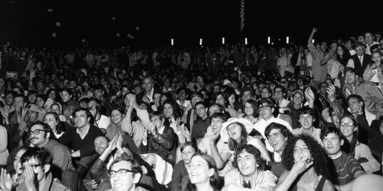 An estimated 10,000 people gathered to watch giant television screens in New York's Central Park and cheered onas astronaut Neil Armstrong took man's first step on the moon on July 20, 1969.