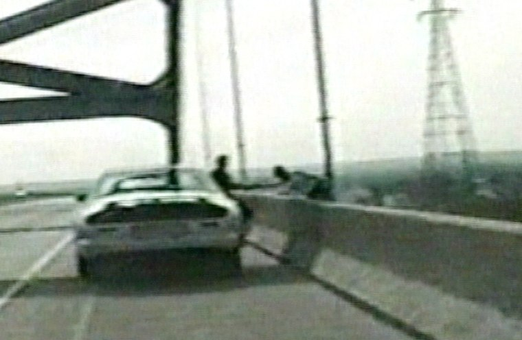A Wisconsin state trooper grabs a woman seconds after she got out of her car and attempted to jump off a bridge.