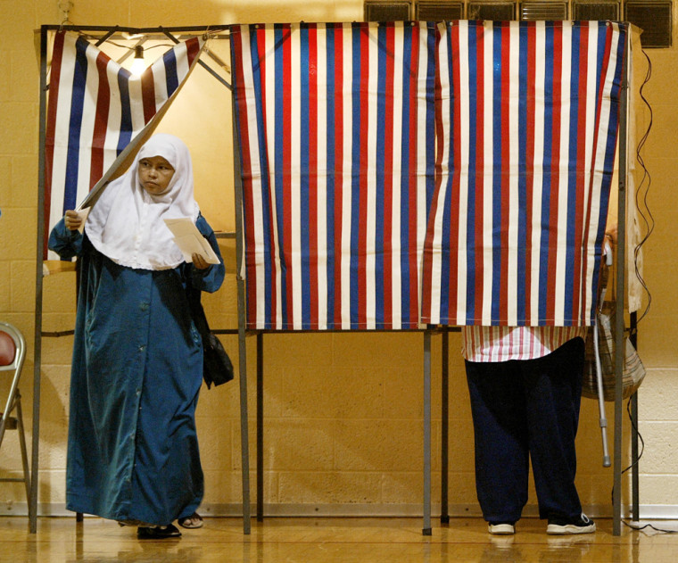 A Hamtramck, Mich. resident leaves a voting booth at the St. Ladislaus gymnasium on Tuesday after casting her ballot on the question of whether mosques should be allowed to broadcast calls to prayer over loudspeakers.