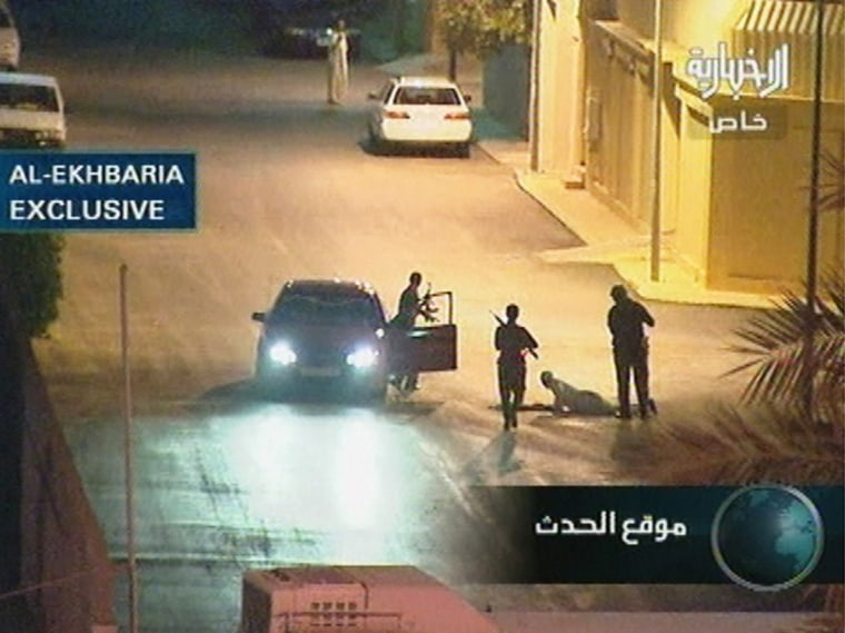 Armed police prepare to search a man lying in the street in Riyadh, Saudi Arabia, during a gunfight with suspected militants late Tuesday evening, in this frame taken from Saudi television.