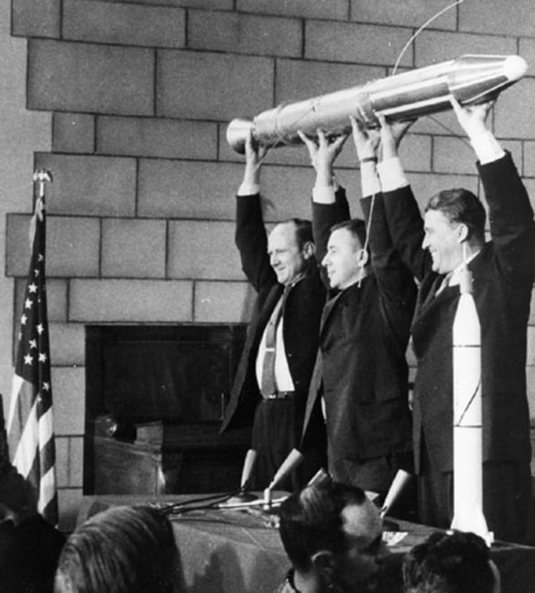 James A. van Allen, center,holds a model of the U.S. Explorer 1 along with William H. Pickering, left, former director of JPL, and Wernher von Braun, right,
