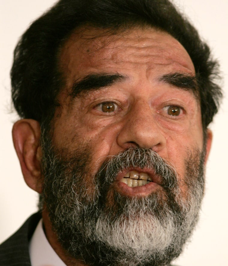 Saddam Hussein appears, shown in a file photofrom a court appearance on July 1 in Baghdad.