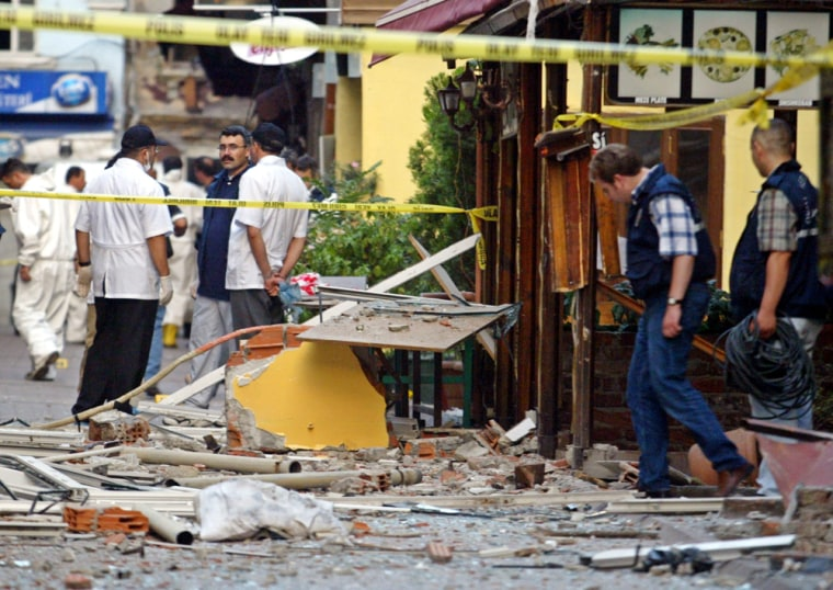 Forensic police examine the site of the Holiday Hotel after a bombing in Istanbul Tuesday.