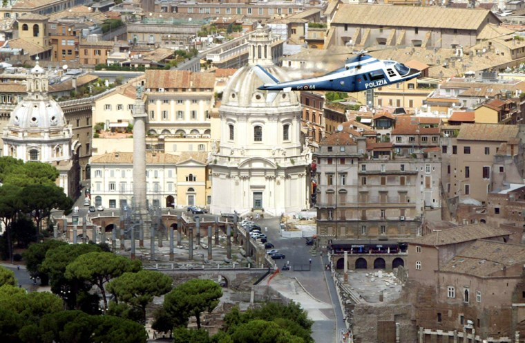 An Italian police helicopter patrols the sky over the Roman Forum in Rome