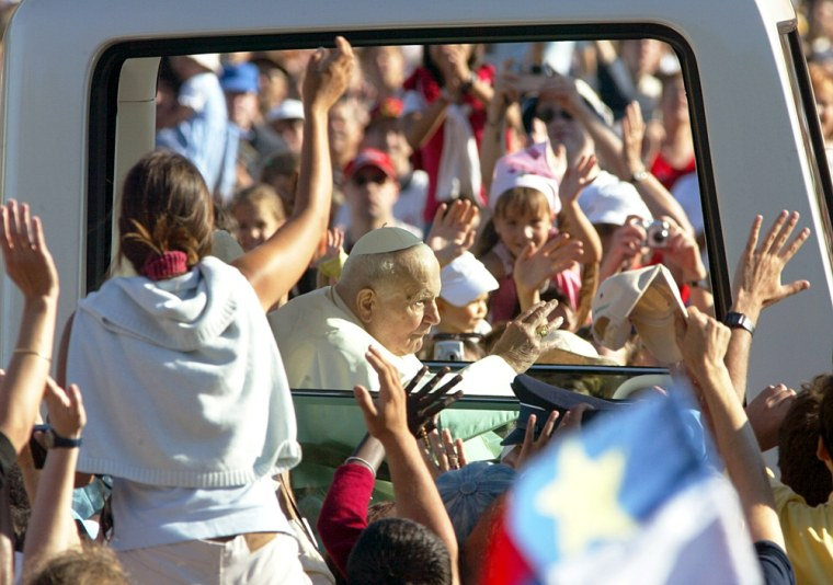 Pope John Paul II is cheered bypilgrims as he arrives for an open-air mass in Lourdes,France, onSunday.