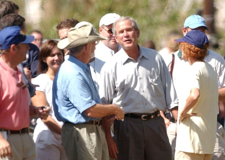 President Bush talks with residents in Punta Gorda, Fla., after touring the hurricane-wrecked area on Sunday afternoon.