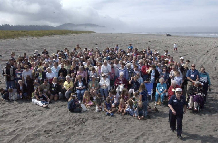 Descendants of the members of the Lewis and Clark Voyage of Discovery gather Sunday for a group photo on the beach at Seaview, Wash. The reunion coincided with the bicentennial celebration of the journey.