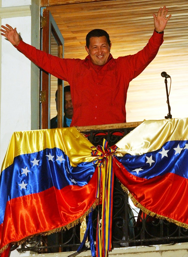 Venezuelan President Hugo Chavez waves to supporters Monday from the balcony of the Presidential Palace in Caracas.