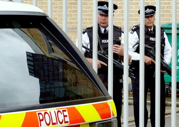 Armed police stand guard at Belmarsh Magistrates Court in London onWednesday as terror suspects appear before the court inside.