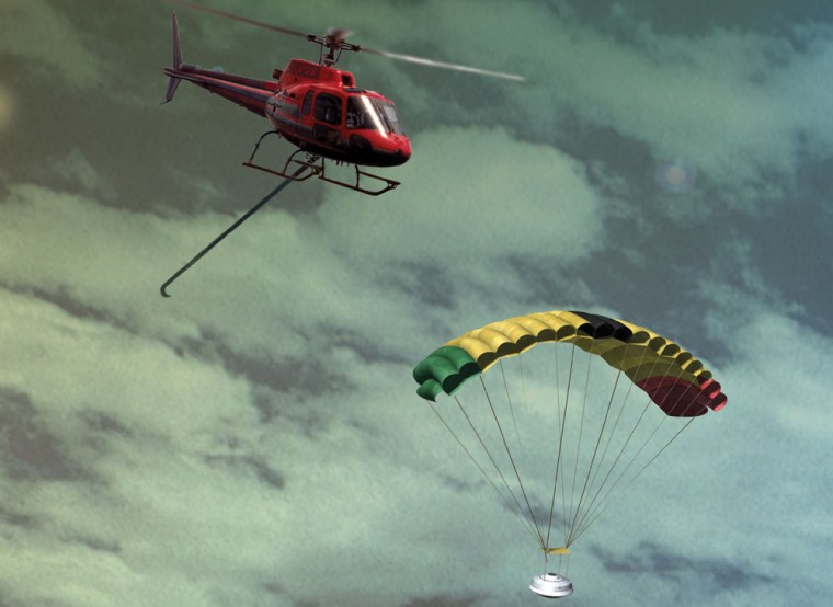 An artist's conception shows a helicopter extending its hook to snag the parachute attached to the Genesis sample return capsule.