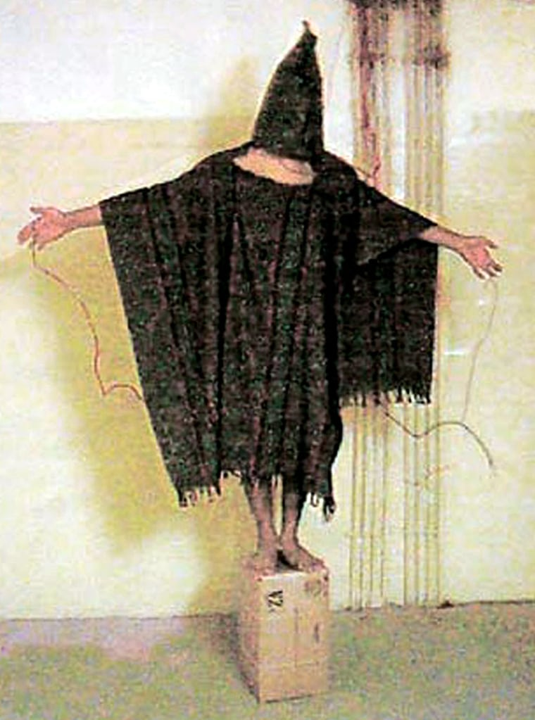 HOODED IRAQI PRISONER IN PHOTOGRAPH COURTESY OF THE NEW YORKER