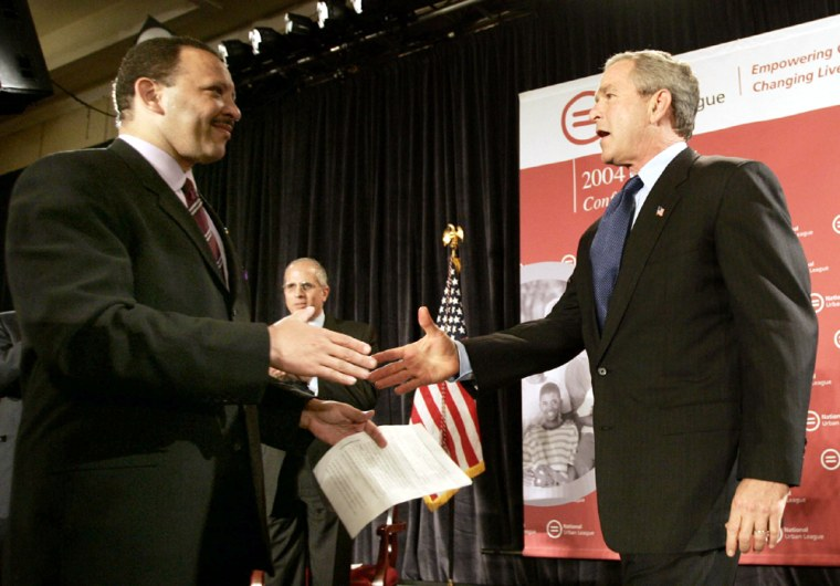 US President George W. Bush greets Marc Morial at an Urban League event in Detroit
