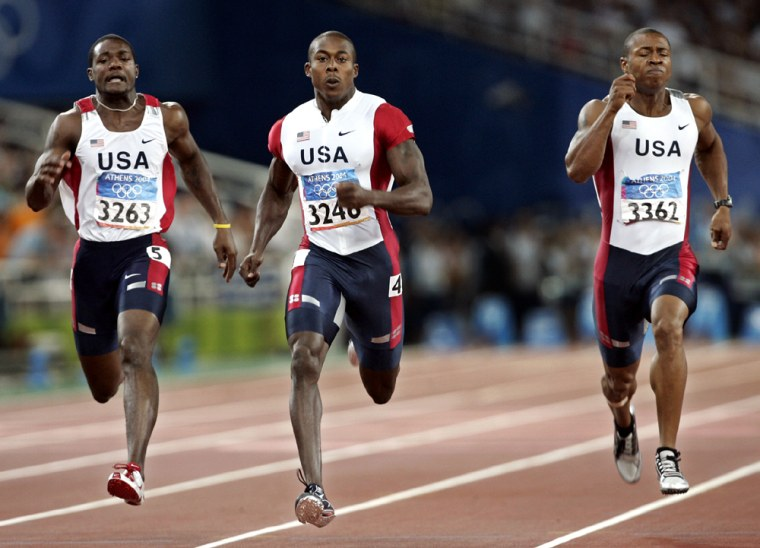 U.S. sprinters Shawn Crawford, center, Bernard Williams (3362) and Justin Gatlin (3263) race in the 200 meter finals at the Olympic Stadium Thursday night.