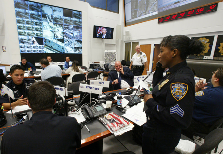 Tucked away in a windowless, eighth-floor roomat an undisclosed location inManhattan, N.Y., members from a variety of military and police units direct a massive security effort, as the start of the Republican National Convention nears.